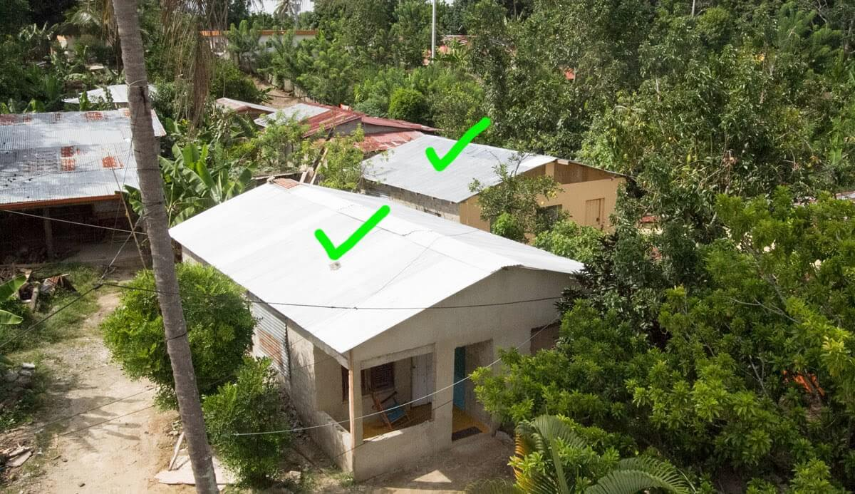 The green check marks show the two houses that our team worked on in June 2013. This photograph was taken in October 2013 while standing on the roof of the church and school building in the village.