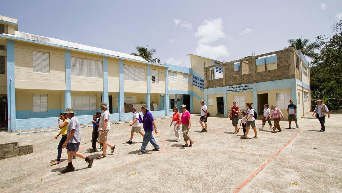 Team members walk past the Episcopal church and school in El Pedregal on their way to the construction sites.