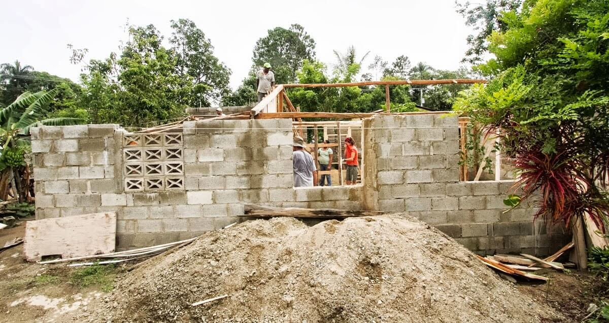 Working on a wall of the new church building in Las Carreras.