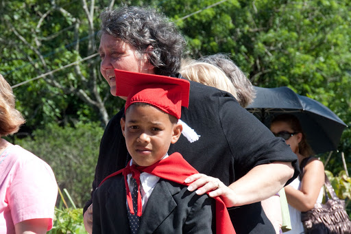 The Rev. Tar Drazdowski accompanies a student in a school graduation parade.