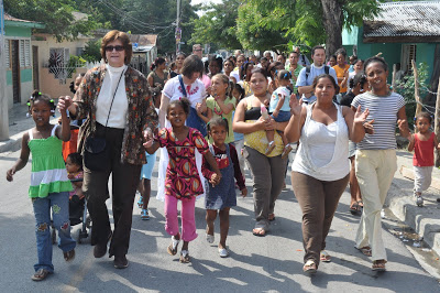 Exploration team members walk with local church members to the construction site of La Reconciliación in Azua, February 2010.