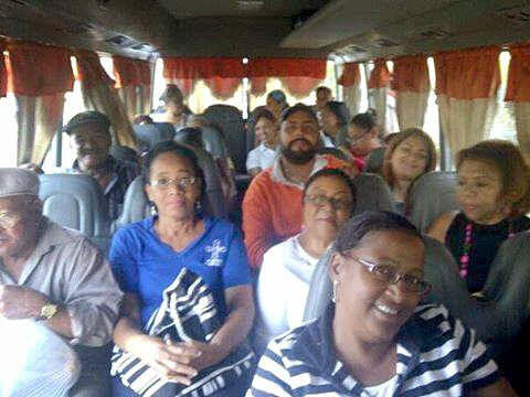 Dominicans on a bus on the way to the optical clinic.