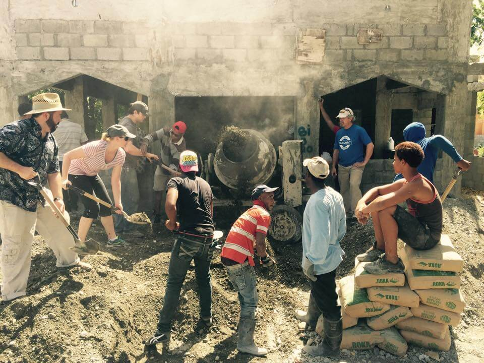 Missioners from St. Anne's Tifton working alongside members of the congregation in Las Carreras to mix concrete for the church floor.