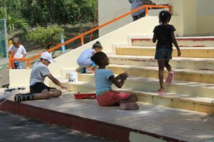 Painting the steps of the local school.