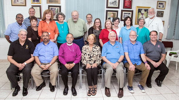 Members and visitors at the DDG Board meeting in Santo Domingo on February 16, 2015. Front row, from left: The Rt. Rev. Dabney Smith (Southwest Florida), The Rt. Rev. Wendell Gibbs (Michigan), The Rt. Rev. Julio Holguín (Dominican Republic - First Vice-President); Virginia Norman (Dominican Republic - Treasurer), The Rt. Rev. William Skilton (Dominican Republic), The Rt. Rev. Todd Ousley (Eastern Michigan), Bill Kunkle (Executive Director). Back row: The Rev. Deacon Alexander Romero (Dominican Republic), David Morrow (President), Sally Thompson (Southwest Florida), Karen Carroll (Dominican Republic), the Rev. Tar Drazdowski (Nebraska), the Rev. Deacon Bob Snow (Nebraska), The Rev. David Somerville (Georgia), the Rev. Emily Griffin (Virginia), Joy Holl (South Carolina), Elizabeth Welch (Central Gulf Coast), the Rev. Deacon Beth Drew (Western Michigan - Secretary), Julia Ariail (Georgia), Julius Ariail (Georgia.