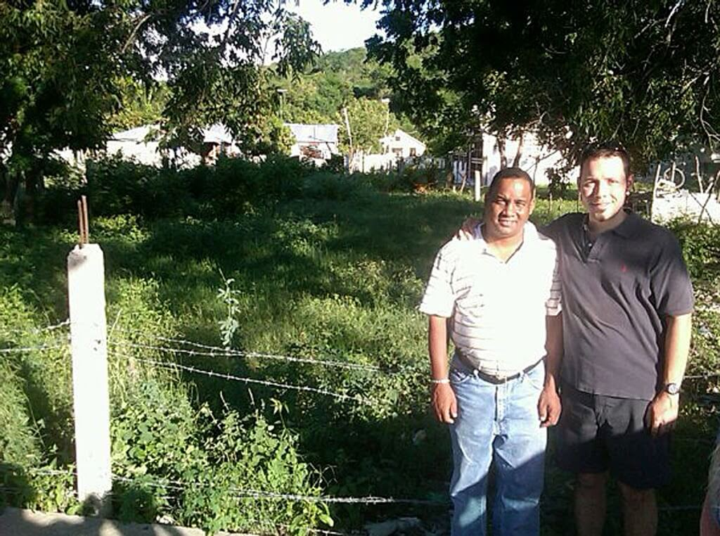 Padre Mosquea and Fr. Weldon at the proposed site for a new Episcopal church near Azua.