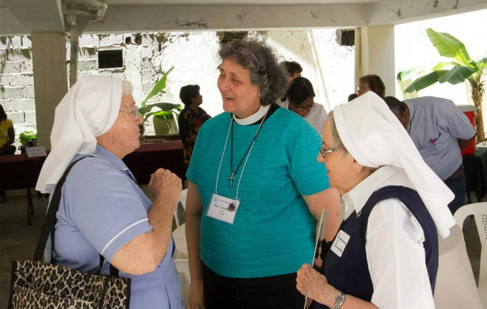 The Rev. Tar Drazdowski talking with two members of the Sisters of the Transfiguration who operate a clinic, school, day care center, and church in a poor neighborhood of San Pedro de Macorís, a large city on the southern coast of the Dominican Republic east of Santo Domingo.