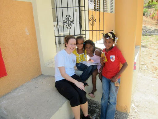 Team member Kate Pontello with local children on the steps of the unfinished high school in El Carreton, January 2012.